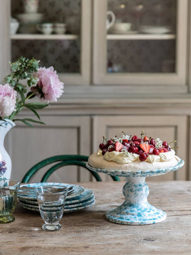 White and blue vintage pattern cake stand with pavlova on top