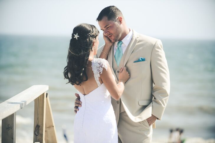 """Tom and I both knew that we wanted something a little nontraditional for our wedding day outfits that would fit with our rustic chic beach theme,"" says Caitlin. Tom's light-weight tan suit and aqua tie mirrored the colors of their beach setting."