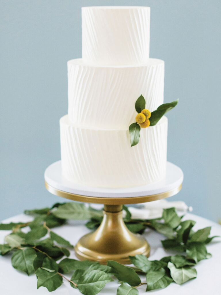 Simple white wedding cake with textured icing