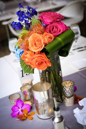 Bright Floral Centerpiece With Orange Roses and Proteas