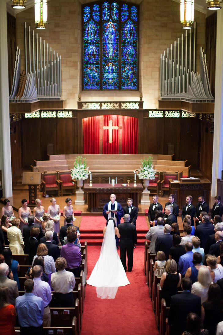 Tessa loved the natural beauty of the church, so she chose to keep the decor to a minimum save for two large floral arrangements that sat on either side of the altar.
