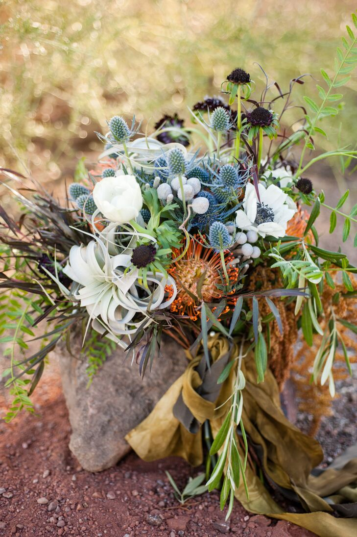 """I wanted something that looked wild. Not something super-fancy, because that's just not me,"" Christa says. ""My florist, Interior Gardens, created the most beautiful boho bouquet, which spoke to who I am: free-spirited."""