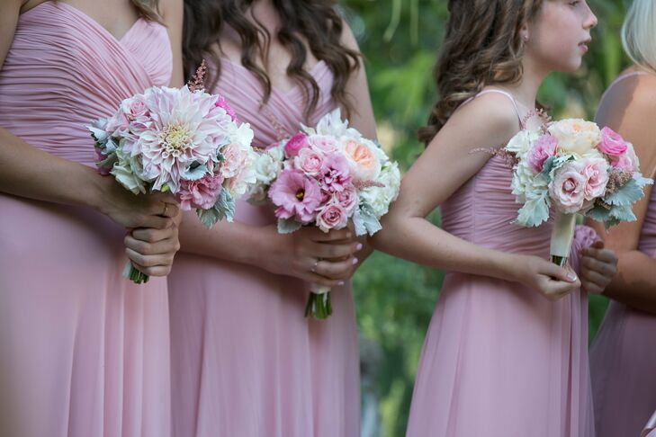 The bouquets were round arrangements of pink dahlias, ranunculuses and roses.