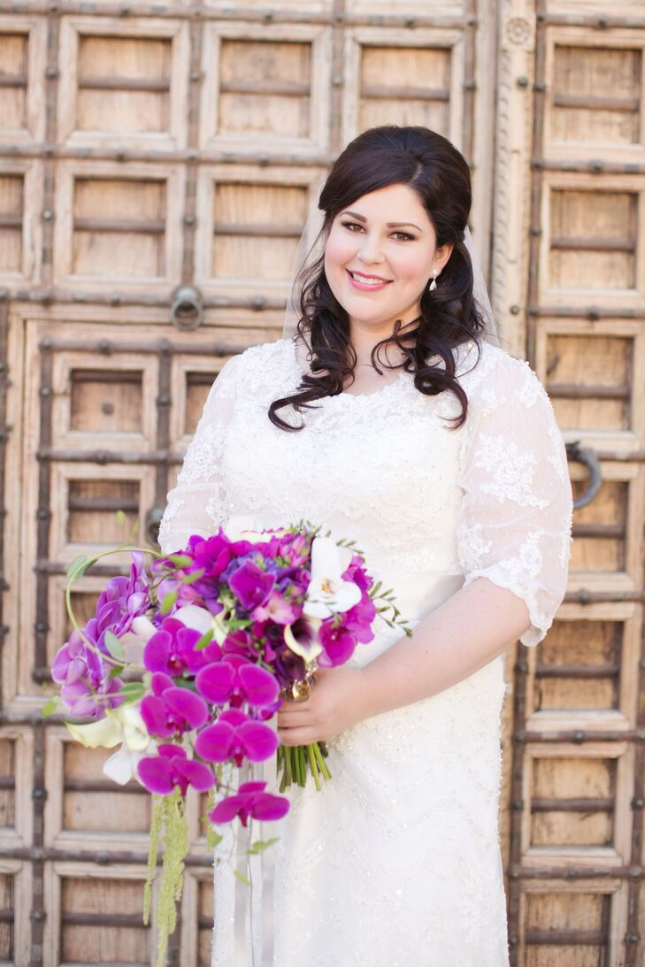 Wedding Dress With Sheer Sleeves And Purple Bouquet