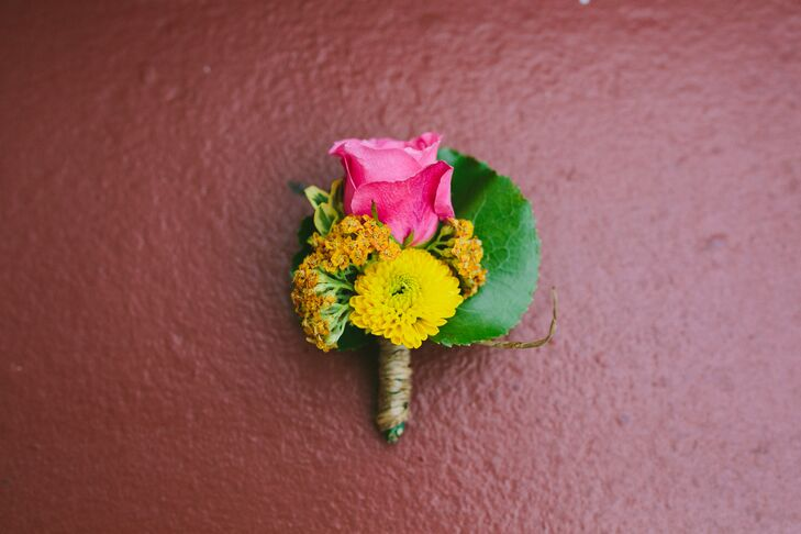 Dustin and his groomsmen added color with bright yellow and pink boutonnieres.