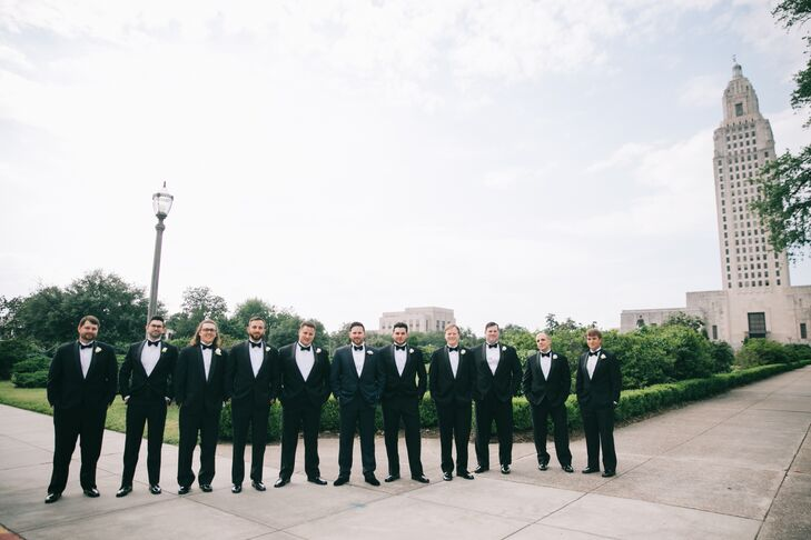 Carson's groomsmen wore the same navy suits as he did, with rose boutonnieres. He had 10 to escort Dawn's five bridesmaids down the aisle.