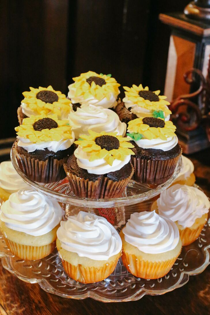 """One type was a double-chocolate cupcake with vanilla buttercream frosting, and the other was white cake with raspberry filling topped with vanilla buttercream frosting,"" Misty says. ""Some of the cupcakes were decorated with sunflowers that were carefully hand-piped.""rn"