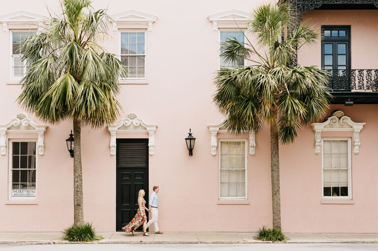 Couple walking in downtown Charleston during summer engagement session