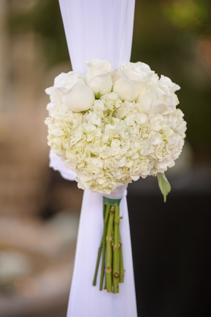 Melissa and Derek decorated their wedding with only a few simple accents. The couple's white fabric-draped chuppah was met with two bouquets of white roses and white hydrangeas designed by their florist, Dalsimer Atlas. Their team also made an all-white bouquet for Melissa.