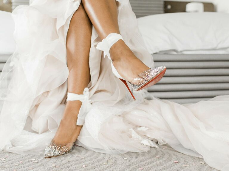 Bride wearing sparkly wedding heels with fabric ties