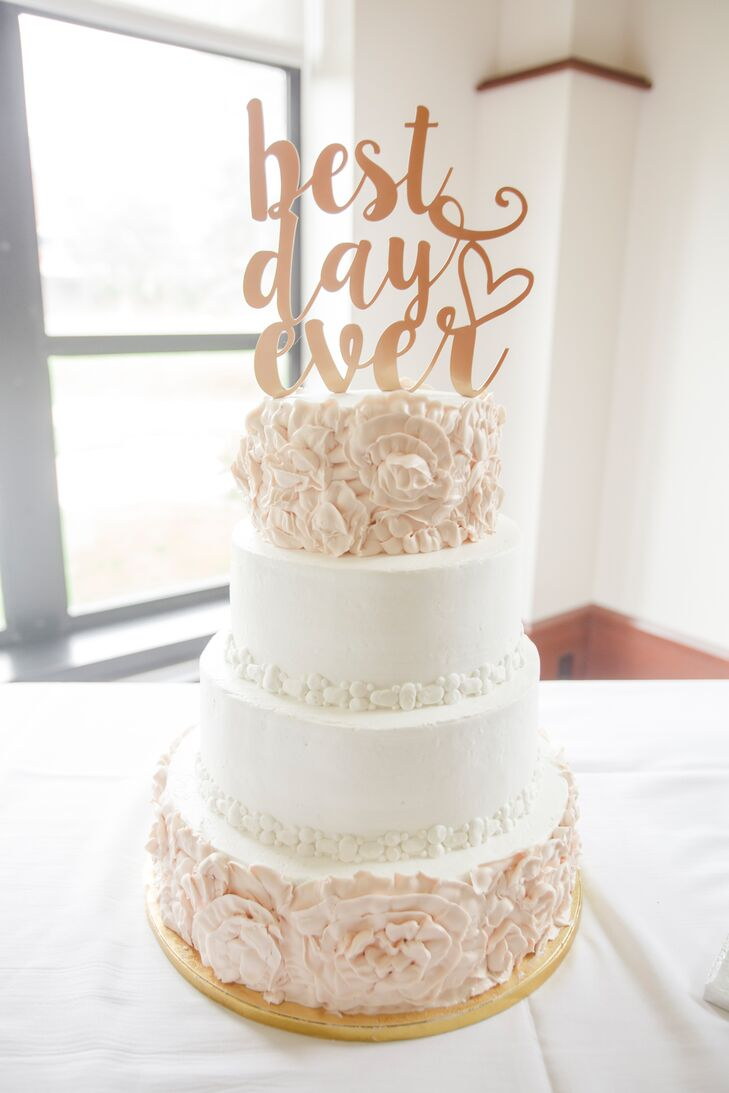 "The four-tier blush and white wedding cake was decorated with a ""Best Day Ever"" topper that Tricia found on Etsy."
