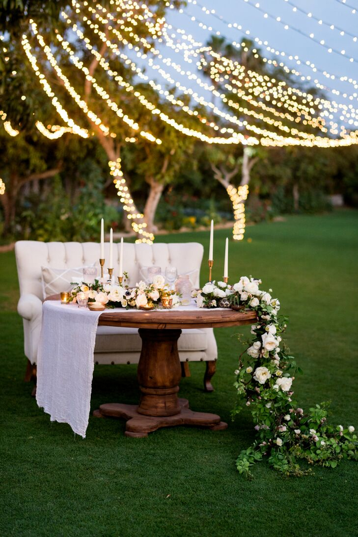 Romantic Garden Rose Garland and Taper-Candle-Topped Sweetheart Table