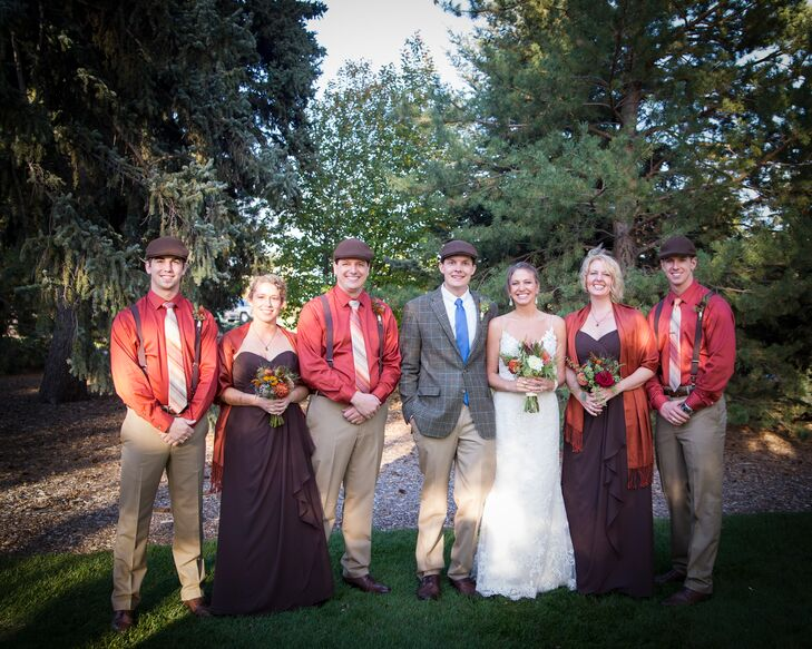 Wanting to match the autumn wedding theme, the groomsmen wore khaki pants with burnt orange shirts and brown suspenders. They completed their look with brown and orange striped ties and brown pageboy hats for the perfect mix of vintage and fall. The bridesmaids wore strapless floor-length brown dresses with burnt orange scarves to match the groomsmen's shirts and to stay warm during the outdoor fall wedding.