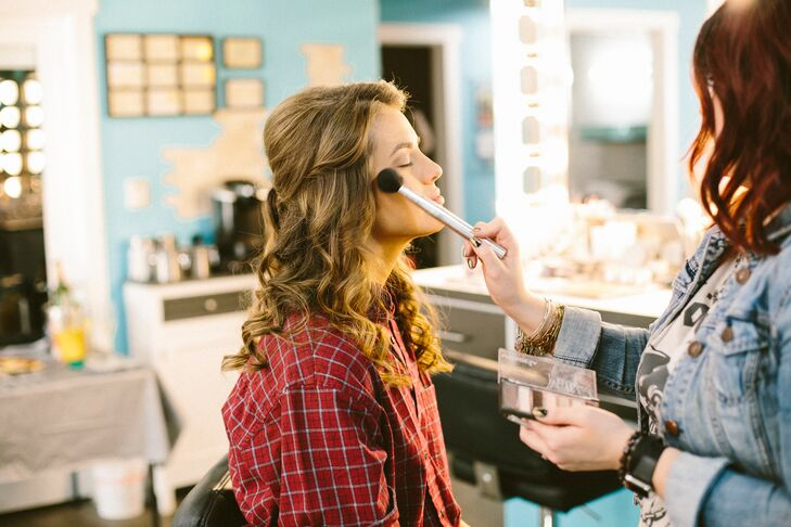 """Kelli's hair and makeup was naturalistic yet refined. """"My hair inspiration was Princess Kate Middleton,"""" says Kelli. """"I love how she always looks effortlessly put together. My makeup was more classic Hollywood glam! I like to make my features pop.""""rn"""