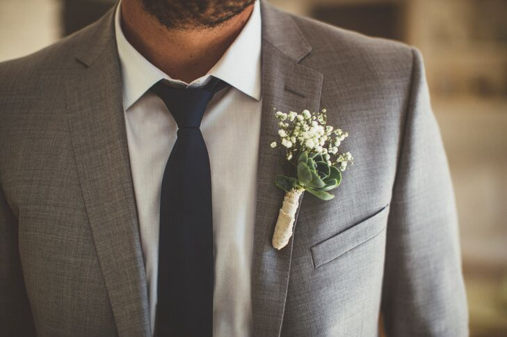 Colin had a succulent and baby's breath wrapped boutonniere pinned to his light gray jacket.
