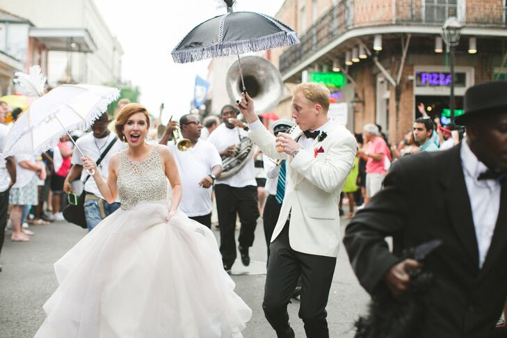 Between the ceremony and the reception, the newlyweds paraded through the French Quarter with a band and all their guests—a New Orleans tradition.