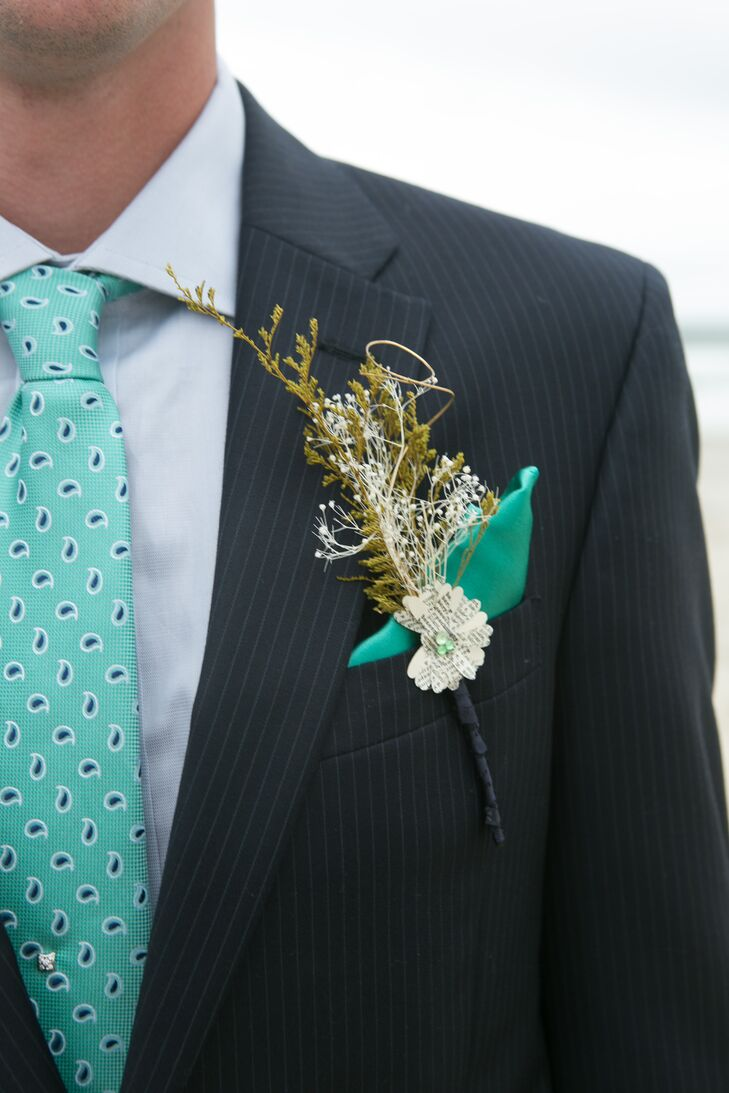 Ken wore a Tommy Hilfiger pintripe suit and an ocean blue paisley tie. The bride made his boutonniere from baby's breath and a DIY book paper flower.