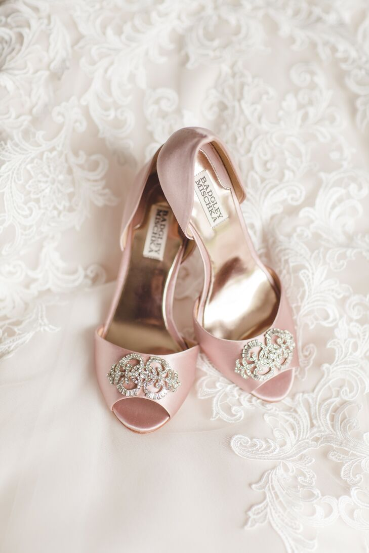 Tricia wore blush pink satin d'Orsay heels with a rhinestone toe detail from Badgley Mischka.