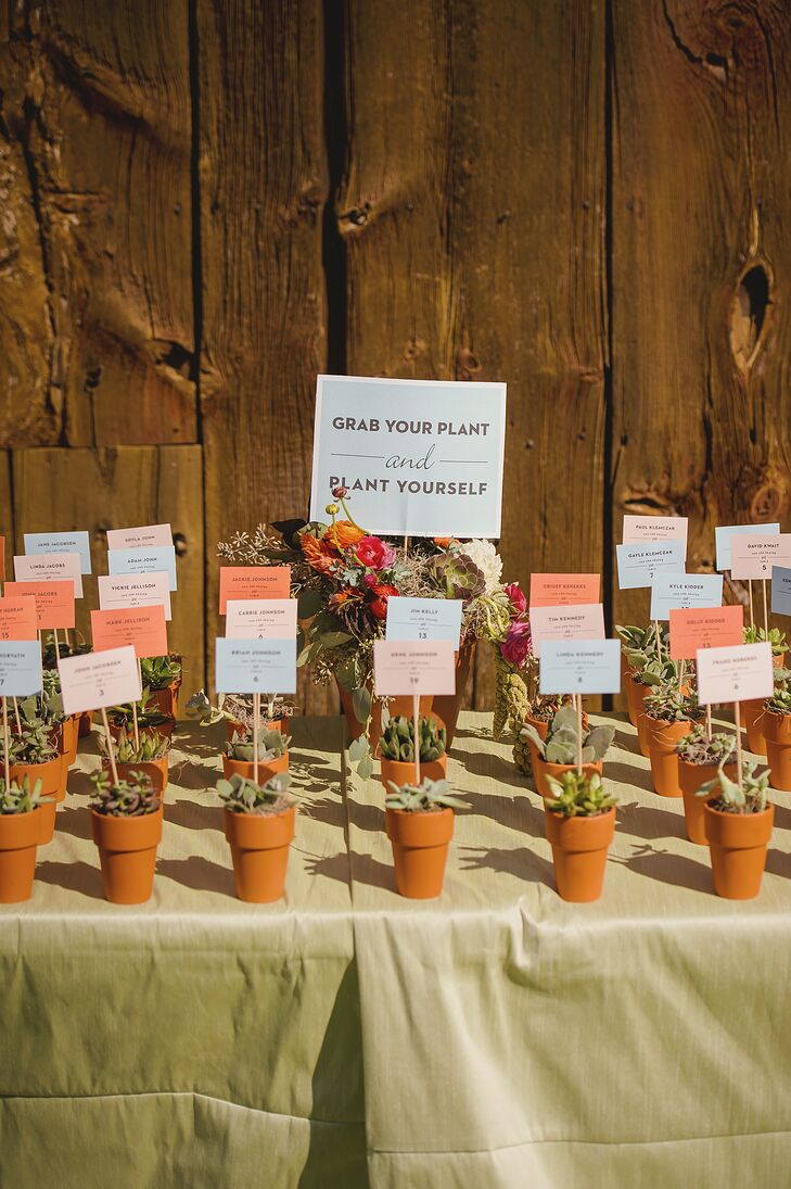 Programs were handed out as guests were seated, while escort cards were placed on sticks and put into potted succulents that ultimately doubled as wedding favors.