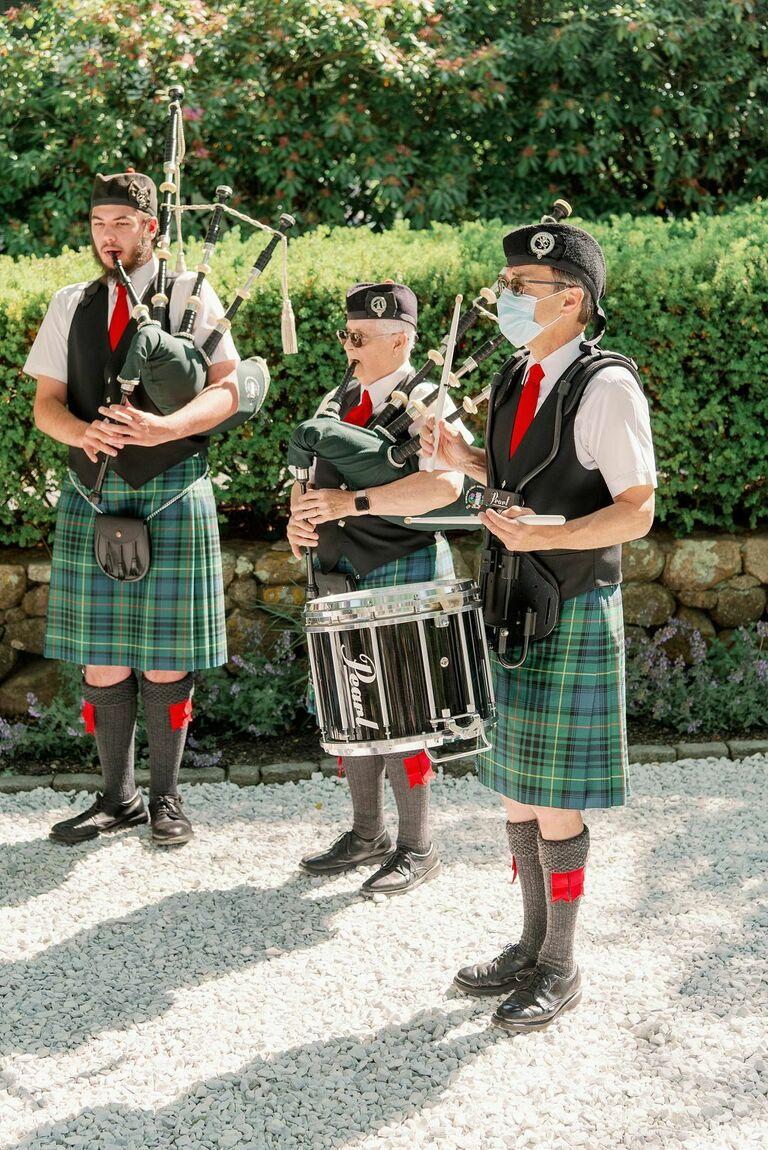Three bagpipers performing at wedding