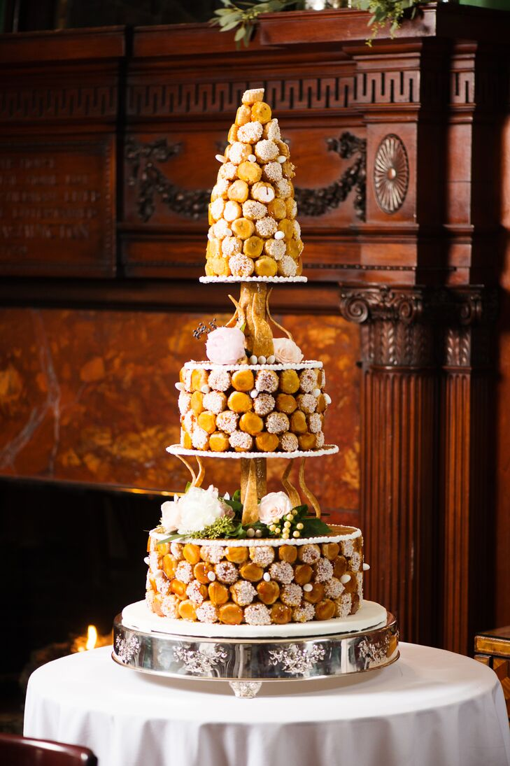 After dinner, the newlyweds and their guests headed to the second floor to dance the night away. But before busting a move, Susan and Solomon treated their family and friends to a slice of wedding cake—an impressive three-tier confection created in the likeness of a classic French croquembouche.