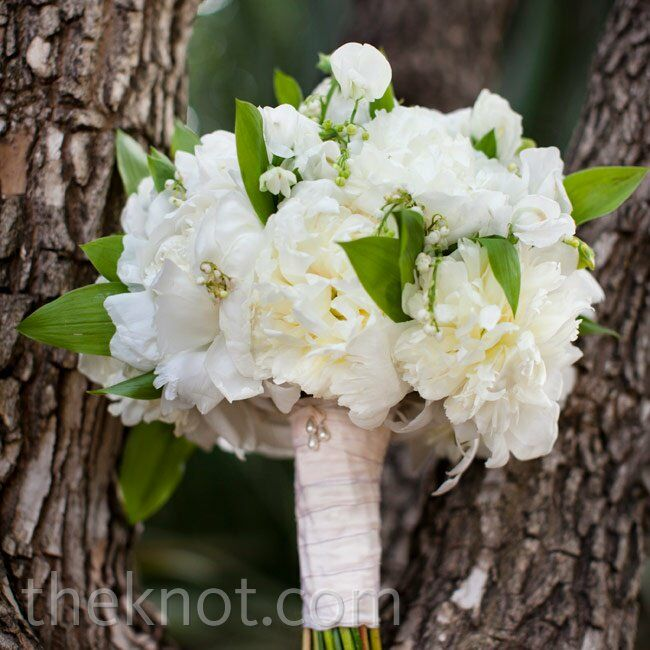 Melissa carried open white peonies with accents of viburnum and lilies of the valley.