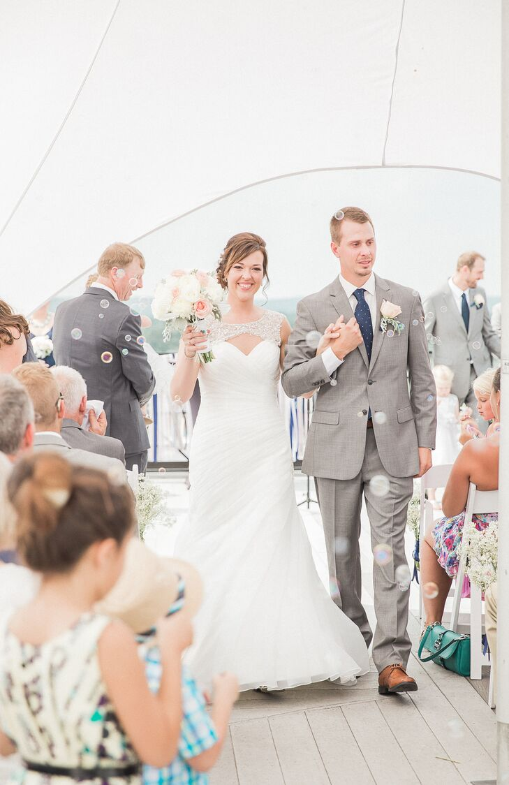 Amber and Adam walked up the aisle amid bubbles and their closest friends and family.