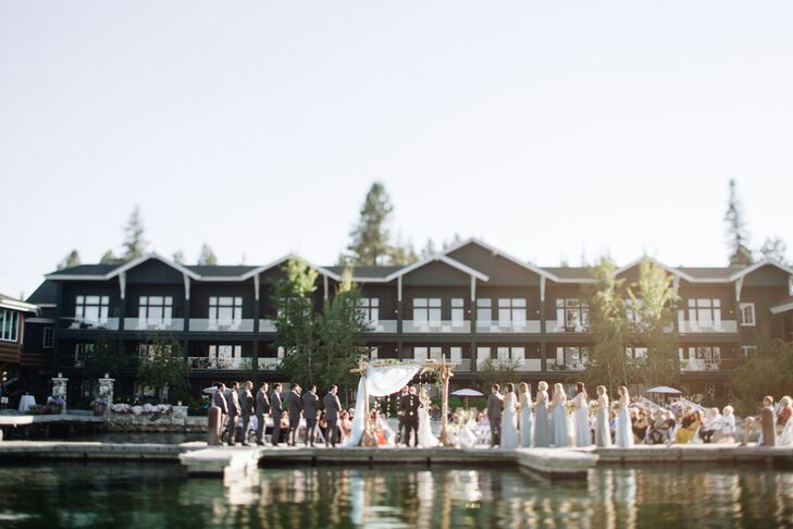 For their ceremony overlooking Payette Lake, Amanda and Anish exchanged vows under an arch made with sea glass, driftwood and 1,000 paper cranes, a Japanese tradition honoring Amanda's roots.