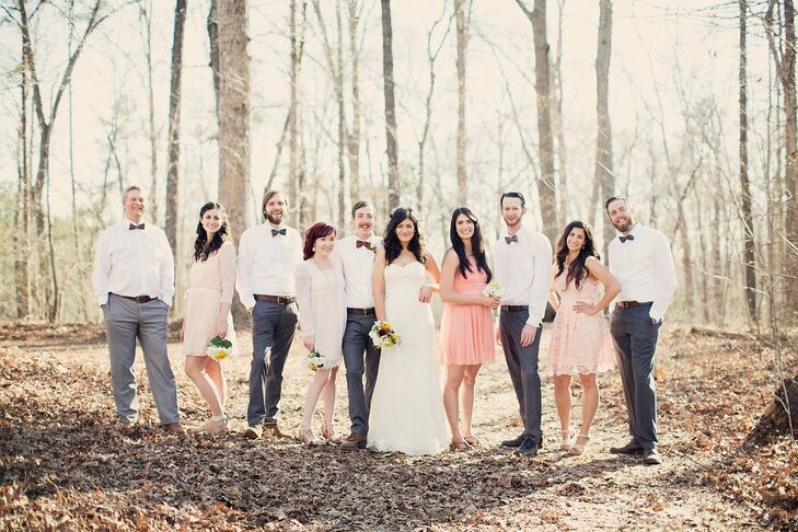 The bridesmaids chose their own light pink dresses, while the groomsmen wore gray pants and mismatched bow ties. The result was a casual look that perfectly complemented the woodland setting.