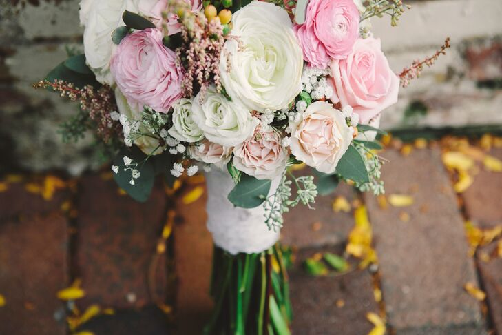The bride's pink and white bouquet was wrapped with lace from her mom's wedding dress and veil.
