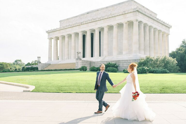 Couple walking in front of Lincoln Memorial in Washington D.C.