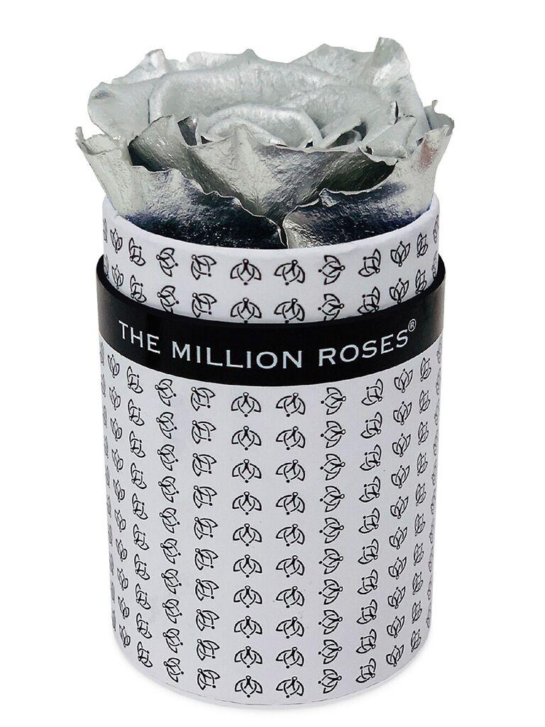 Silver preserved rose in black-and-white logo box