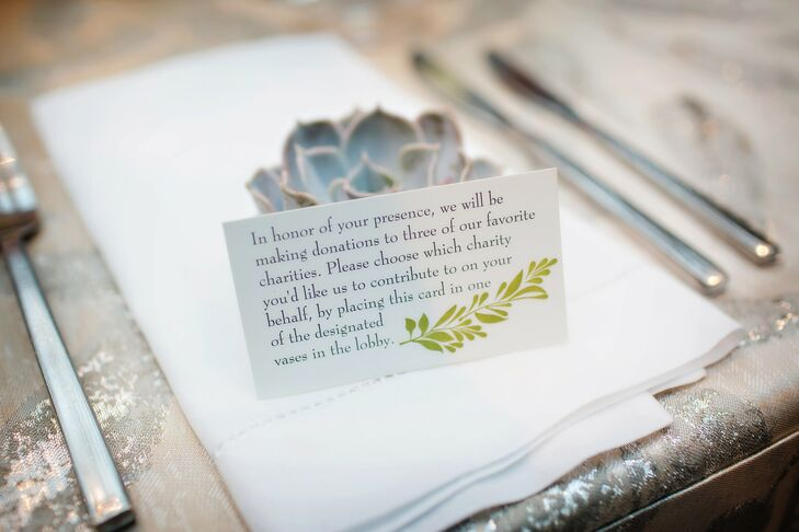 A small card at the place settings let guests know that the couple would be making a donation to one of three charities.