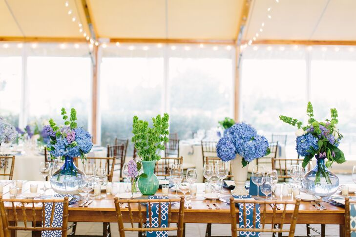 "Sayles Livingston Design took the couple's elegant, eclectic vision and ran with it, creating varied arrangements, both tall and small, in brilliant shades of blue, white, green and lavender to bring the reception tables to life. The loose, textured centerpieces were placed in assorted vases that Danielle and her mother collected during the planning process, including ginger jars that had belonged to Danielle's grandmother. ""No two tables were the same thanks to a variety of pattern, color and height,"" Danielle says. ""With touches such as these, we were able to create an aesthetic different from your average wedding decor."""