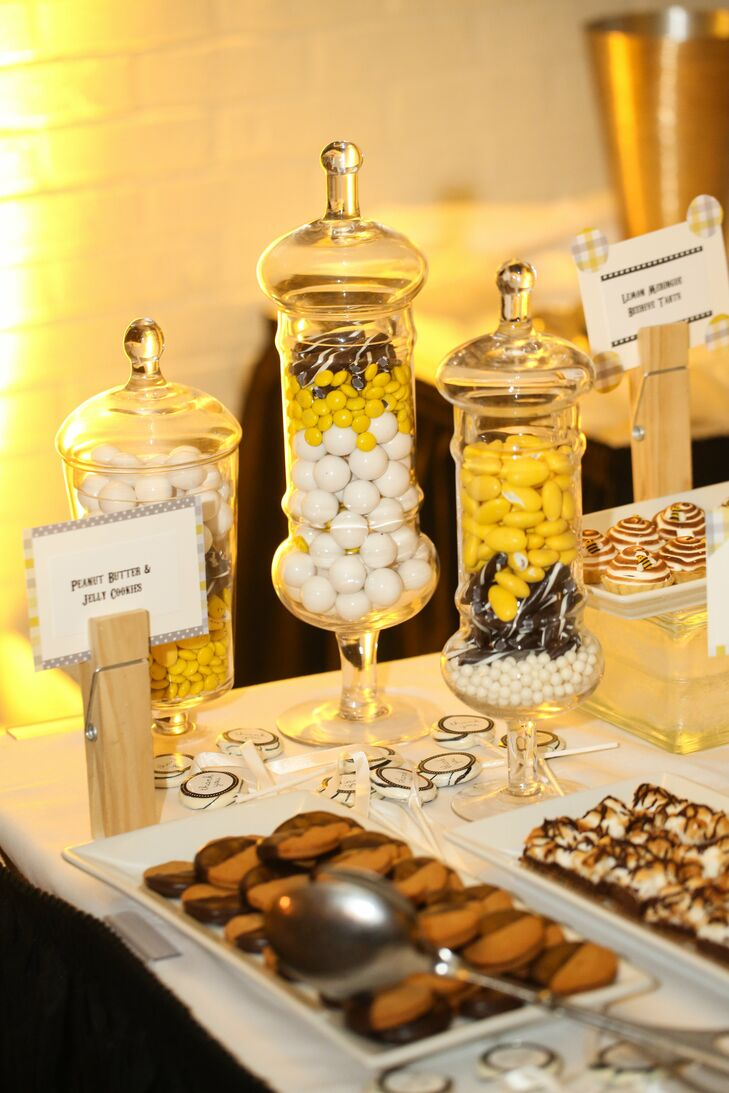 The couple chose not to have a traditional wedding cake, opting for a dessert bar filled with miniature size treats instead.
