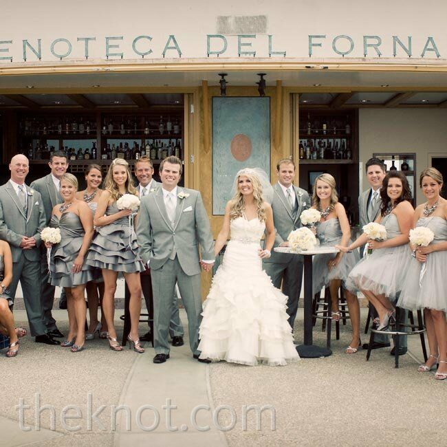 The bridesmaids wore a mix of pewter and platinum dresses: some with tiered ruffle skirts, others with textured tulle. The guys complemented the look with retro gray tuxedos.