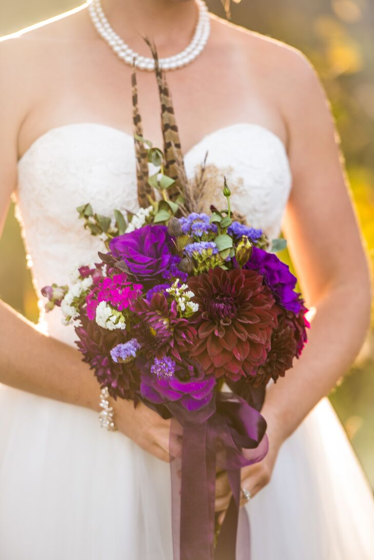 Dawn carried dahlias, roses, hydrangeas and wildflowers in different shades of purple for her bouquet. In honor of her pheasant-hunting father, she added some feathers to her bouquet too. It was important to the couple for the flowers to be sourced locally, so they chose Zephryos in Paonia, Colorado. They stopped by the farm and got 20 gallons' worth of flowers, and created all the arrangements themselves.