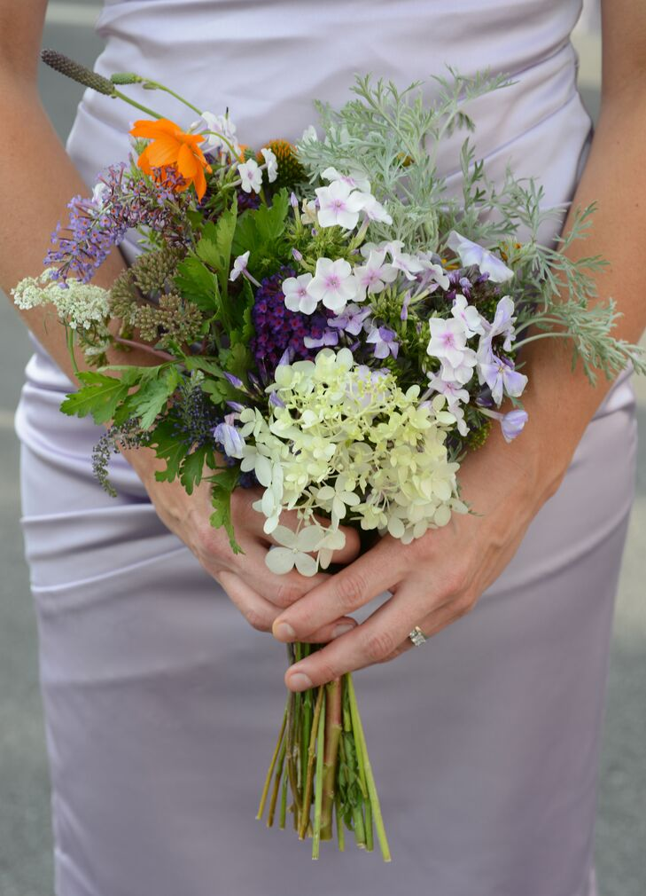 All of the wedding's flowers were locally sourced. The flowers were fresh picked the day of the wedding and then arranged into bouquets, boutonnieres and centerpieces by Rebekah and her family.