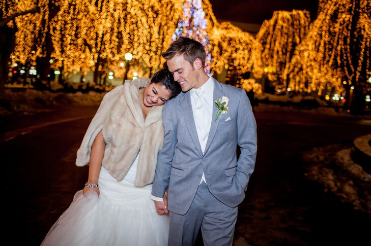 """After the reception, Emily and Phillip took a Winter Stroll through Rice Park, which was decorated for Christmas with twinkle lights and an ice rink. Emily says, """"It was the perfect romantic setting for a winter wedding."""""""