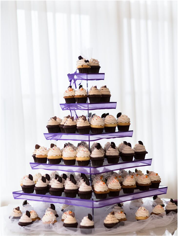 Carrie and Josh decided to skip out on traditional wedding cake, instead serving a variety of cupcakes, including chocolate peanut butter, oreo cookie, carrot cake and vanilla.