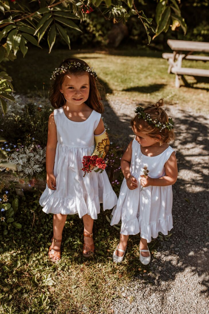 Bohemian Flower Girls Wearing Short White Dresses and Flower Crowns