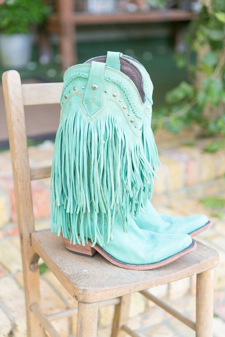 Now these are some bold wedding shoes! To match their palette, Katie picked out a pair of turquoise cowboy boots by Liberty Black that had suede fringe along the sides and funky silver studs by the rim.