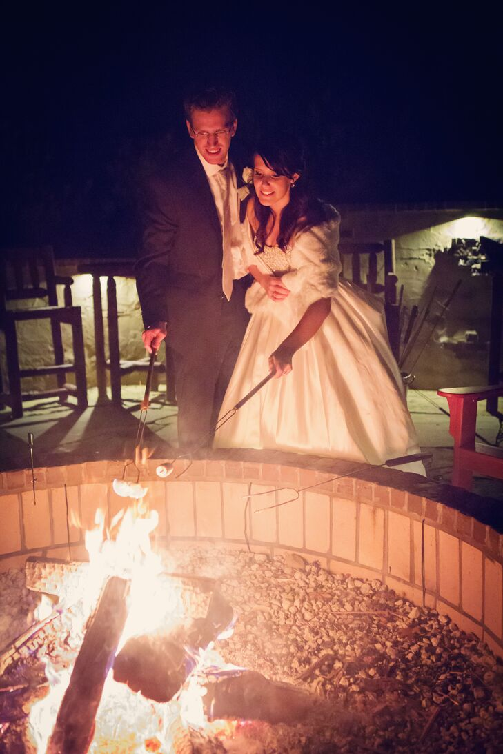 """For their Christmas-themed wedding, the couple provided warm desserts for their guests, including a DIY s'mores bar over a fire pit. """"Our simple touches like the hot-chocolate and s'mores bar by the fire pit truly made it memorable,"""" Courtney says."""