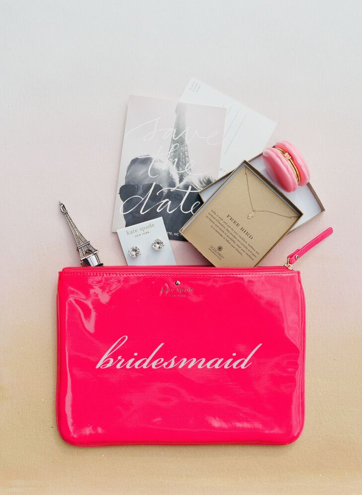 "Lynn purchased pink Kate Spade rnGia bags that said ""bridesmaid"" on them. Each was filled with a set of Kate Spade crystal earrings and a dog-eared necklace that Lynn specifically picked to represent a meaningful time in their lives as friends."