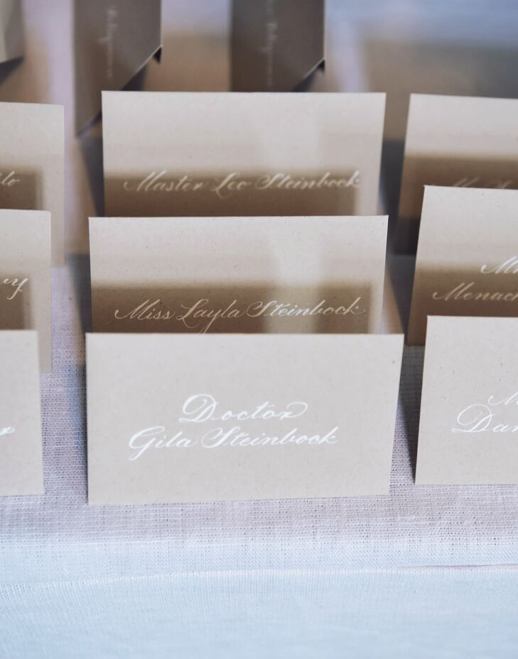 The couple's recycled kraft paper escort cards were hand-calligraphed.