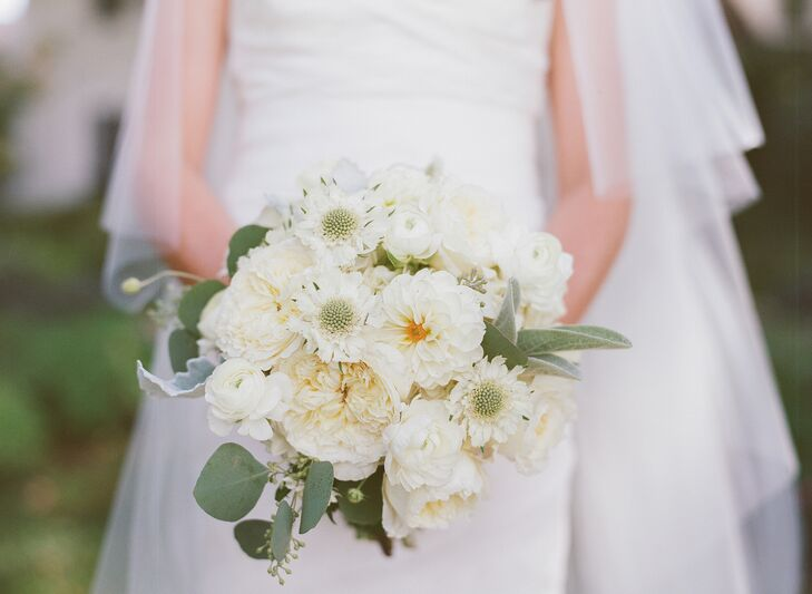 """My bouquet and all the flowers at the reception were very natural—all whites, creams and lots of mint greenery,"" says Casey. ""I really wanted peonies, but since they weren't in season, we used a variety of similar flowers instead."""