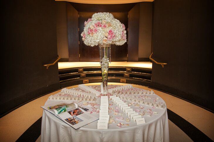 Each of Shira and Yoni's 175 guests were met with a tall place card display of white hydrangeas and pink roses as they entered the reception.