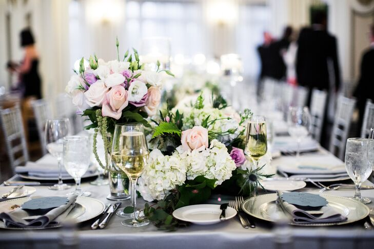 """""""I knew I wanted an interesting blend of flowers and textures and a growing-out-of-the-table feeling,"""" Rachel says. A mix of roses, hydrangeas and greenery in pinks, purples and whites were used to create whimsical floral arrangements."""