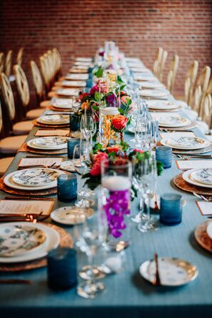 Rectangular Dining Table with Candles and Colorful Centerpieces