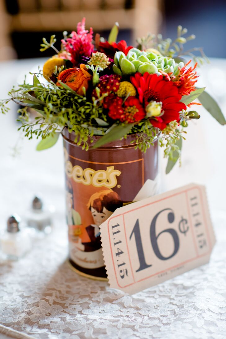 Maggie, her sister and her mother collected vintage born bottles and tin containers from antiques stores around Virginia and New Orleans, filling them with twinkle lights and wedding flowers. Tables were dressed in light beige clothes, with half using lace runners and the other using half lace overlays.